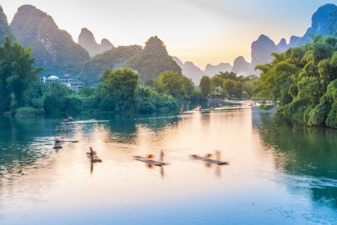 Landscape of Guilin. Tourists are visiting by Bamboo raft. Located in Yangshuo, Guilin, Guangxi, China.
